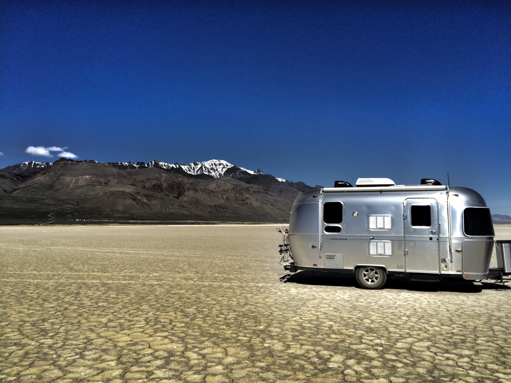 Our sweet 19 foot Airstream on Alvord Desert last year.