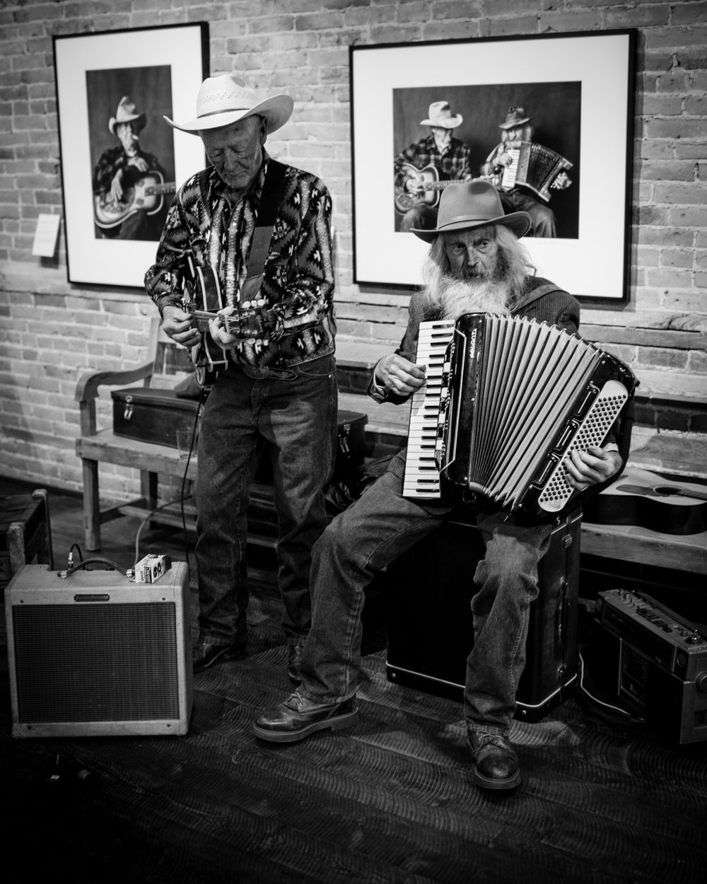 Two of the cowboys featured in the book - John Hoiland on the accordian and Jim Larkin on guitar