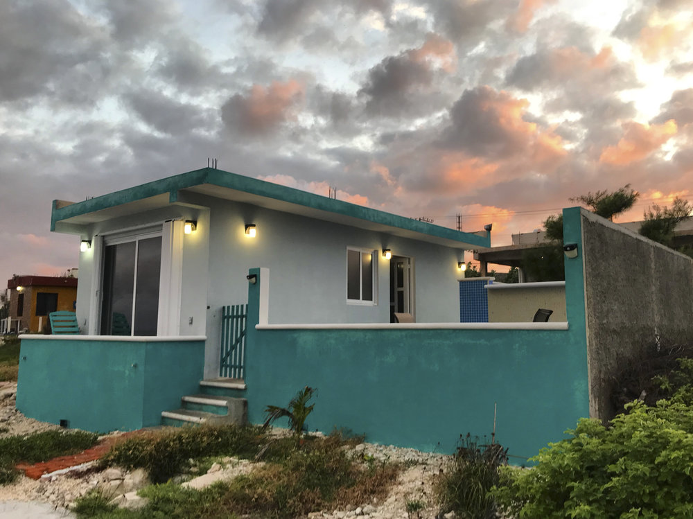 Our sweet Airbnb on Isla Mujeres and the amazing sunset that welcomed us our first night.