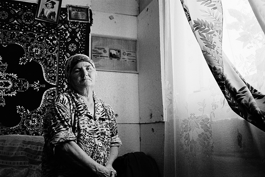 This older woman is from the Crimean Tatar community in Ukraine.  The entire Crimean Tatar community was deported from Crimea in 1944 and forced to settle in Uzbekistan.  Many began to return to Crimea in the early 1990s but after the breakup of the USSR, many became stateless.