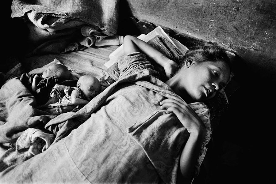 This woman from the Urdu-speaking community in Bangladesh is exhausted and sick.  She rests with her newborn twins.  Only weeks old, they do not have access to proper healthcare. Both already suffer from malnutrition