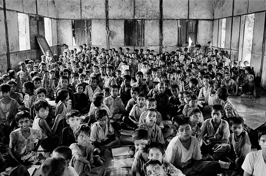 Several hundred children from the stateless Rohingya community in Myanmar attend an informal school in a camp in Myanmar.  The children have not been permitted to attend a proper school for almost three years.