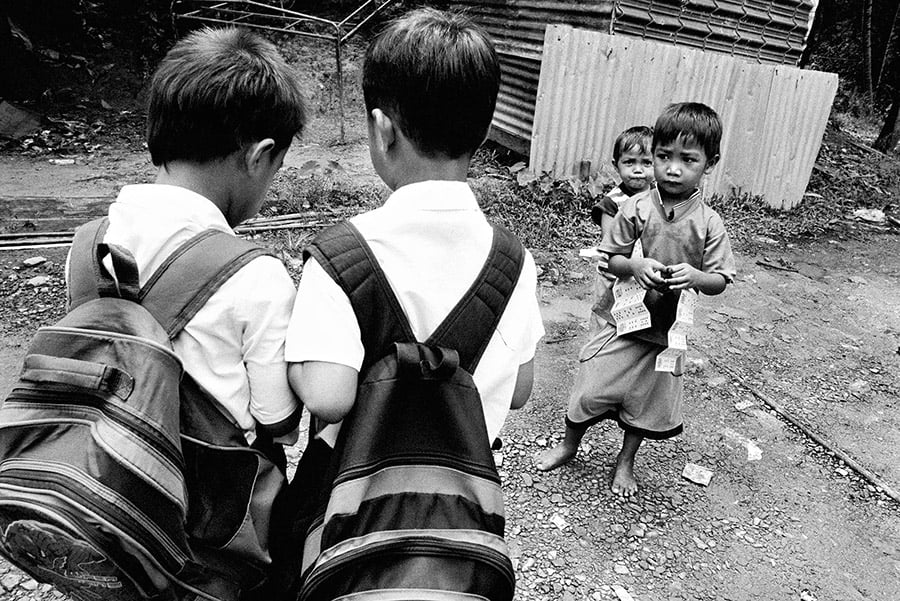 A slum outside of the city of Kota Kinabalu in Sabah, Malaysia is filled with stateless youngsters. Children who possess the right documents are able to attend private schools and some public primary schools. Those who don't are shut out of most public programmes.
