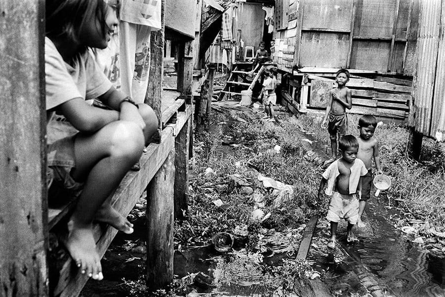 A group of stateless children play in a slum outside of Kota Kinabalu in Sabah, Malaysia.