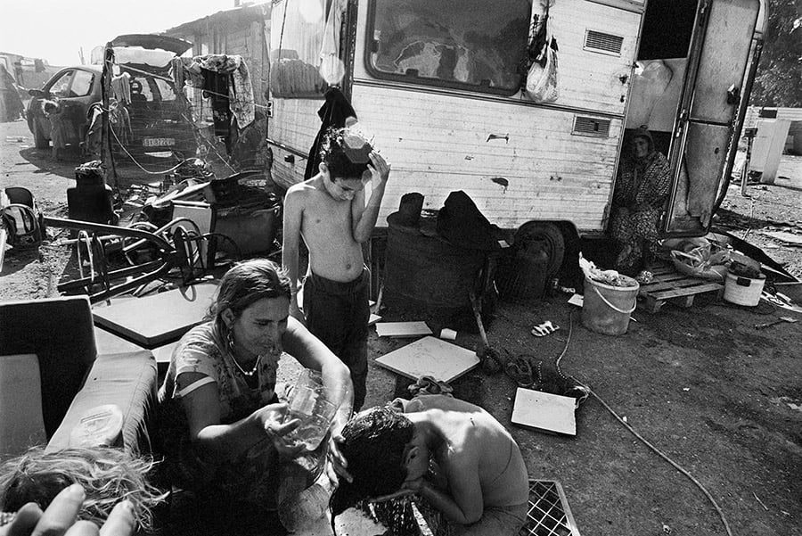 Most stateless people from the Roma community in Italy are forced to live in camps that are isolated from the cities.  A mother gives her child a bath in their Roma camp outside of Naples, Italy.