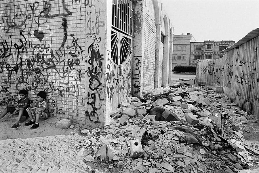 Two children from the stateless Bidoon community in Kuwait sit in the Bidoon slum of Taimaa.