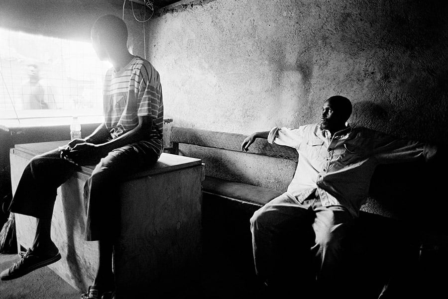 Two unemployed youth from the Nubian community in Kenya sit in a youth centre in Kibera. For years, young Nubians had to go through a nationality verification process called vetting, which caused difficulties for Nubian youth to obtain National ID cards.