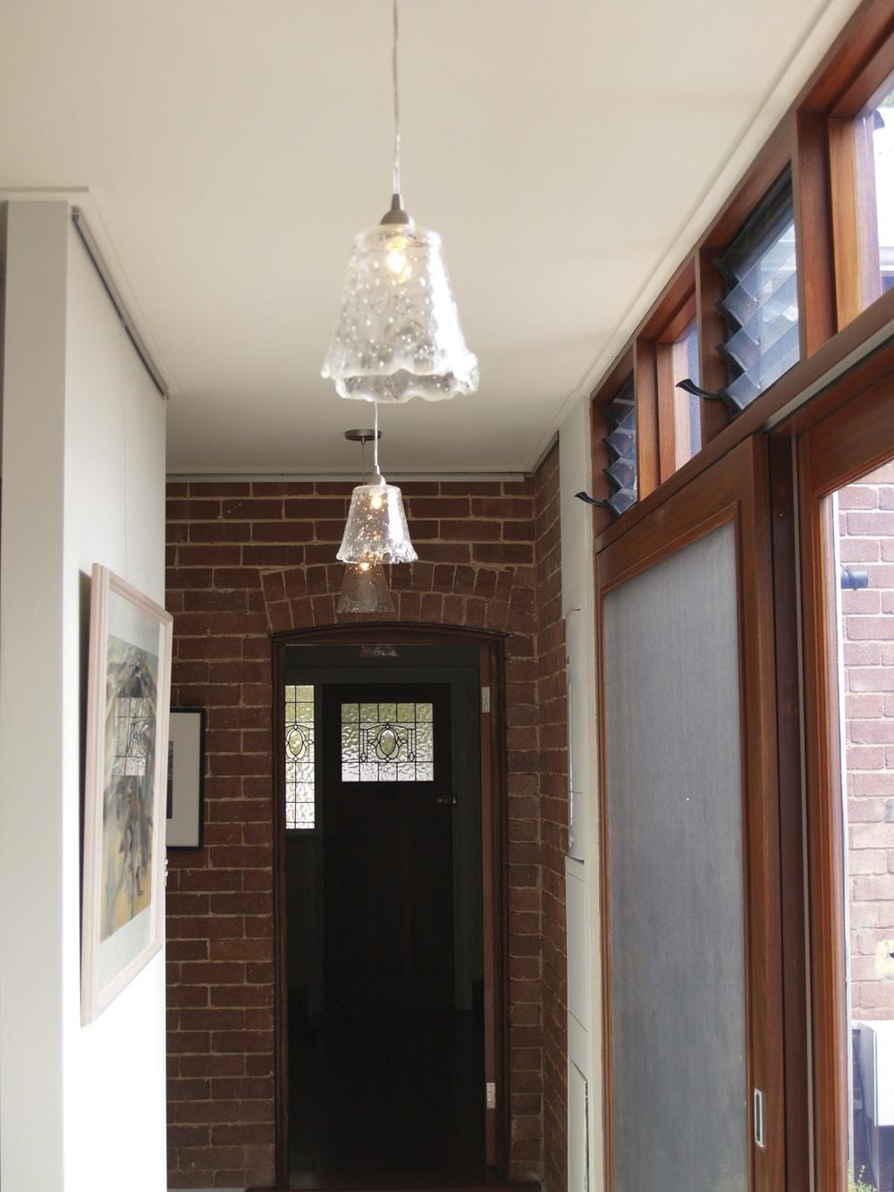 Hanging lights down the hallway