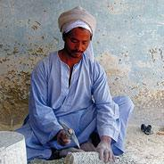 There's ongoing restoration of the ruins. Here a worker shapes a stone