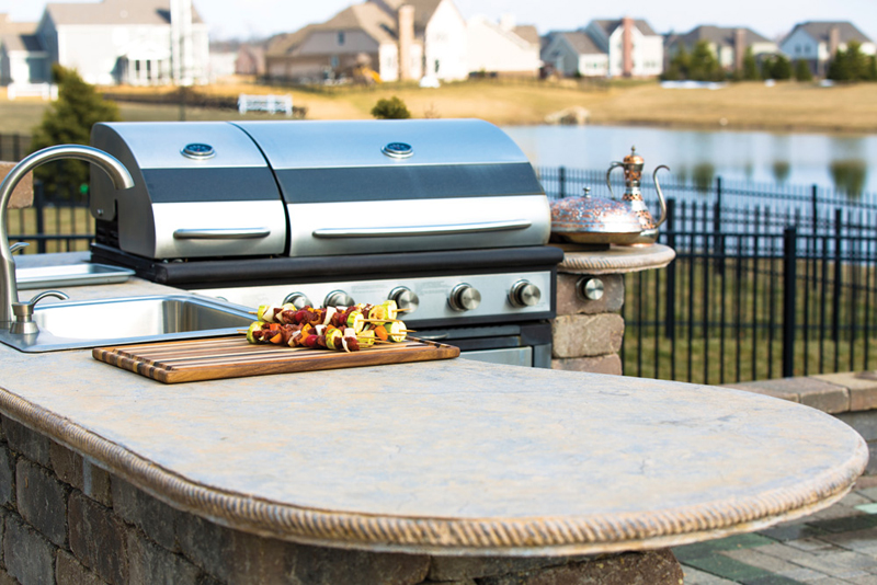 Tip: A small built-in fridge is a popular choice for outdoor kitchen areas. Having icy cold drinks conveniently located prevents guests (and you) from constnatly going in and out of the house.