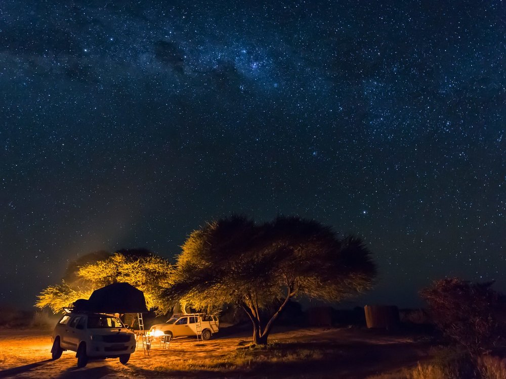 Sleep under the stars in the Kalahari. Image from Getty.