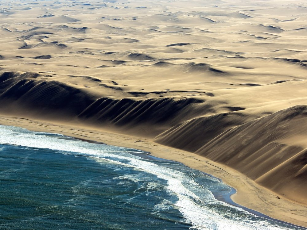 Tour the Namibian Skeleton Coast from above with the Schoeman brothers. Image from Getty.