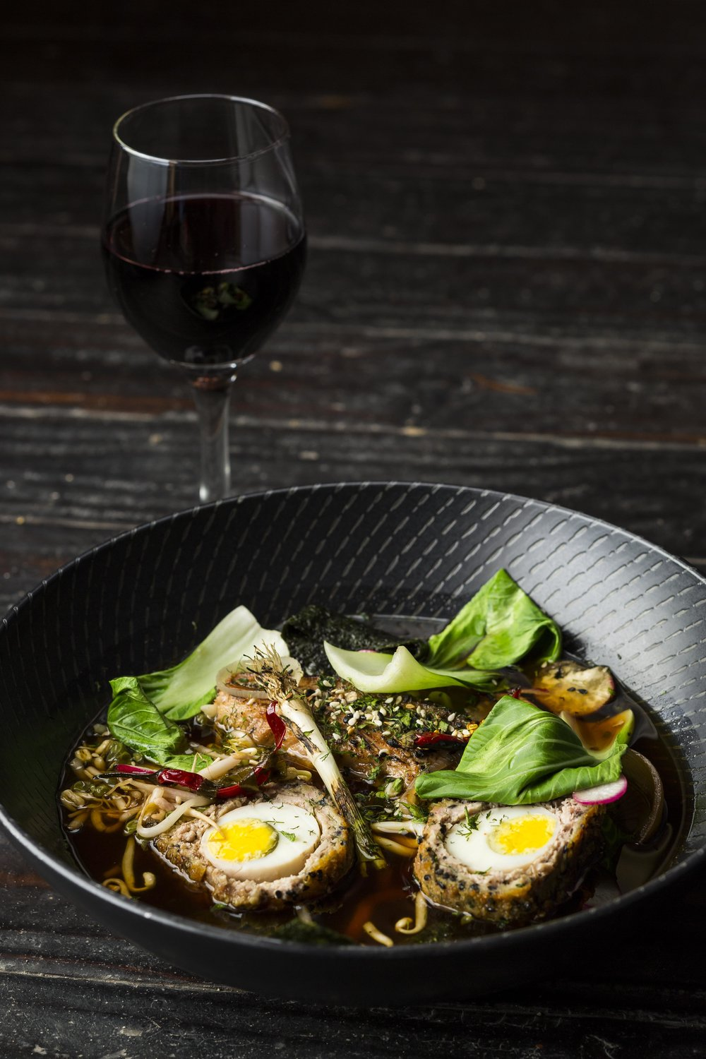 Rock 'n' Roll Ramen - Pork belly ramen with a soft-boiled scotch egg, udon noodles, spring onion, toasted sesame, Chinese leaf & bean sprouts in a lemongrass broth. Image by Michael le Grange.