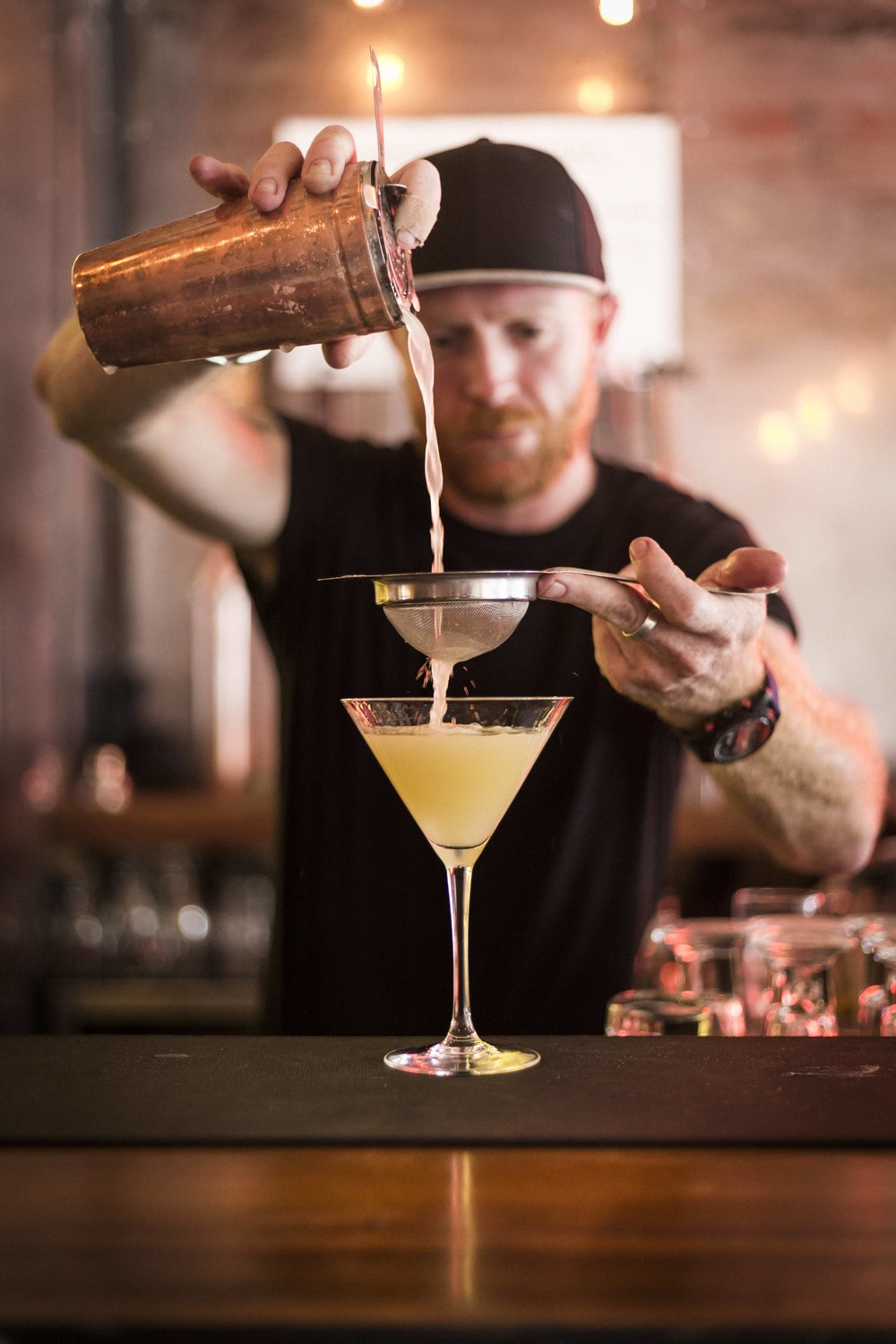 Rory preparing an Apple Martini. Image by Michael le Grange.