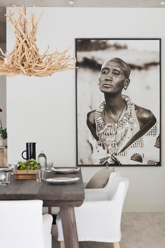 Michelle took the photo of a Masai woman while on holiday in Kenya. Chandelier, dining table, dining chairs, cushion and tray,all from Blupeter Homestore.