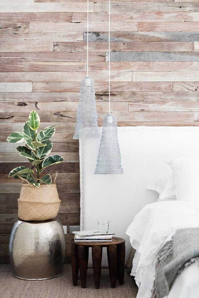 A feature wall of weathered hardwood panelling provides a colour and textural contrast to the room's predominantly white scheme. The side chair belonged to Michelle's grandmother.
