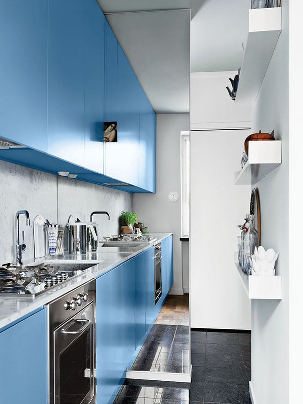 If you ever doubted the idea of a galley kitchen, this modern Swedish remodel is sure to change your mind. With lots of reflective surfaces and an 8.5 ft x 3.3 ft floor to ceiling mirror at work, there is plenty of light to enhance this cleverly designed and compact space.
