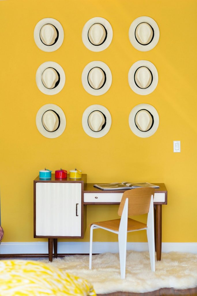 Home-office-in-midcentury-modern-with-a-collection-of-decorative-hats-on-the-wall-683x1024.jpg