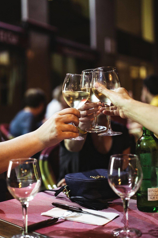 kaboompics_Friends at a restaurant drinking wine.jpg