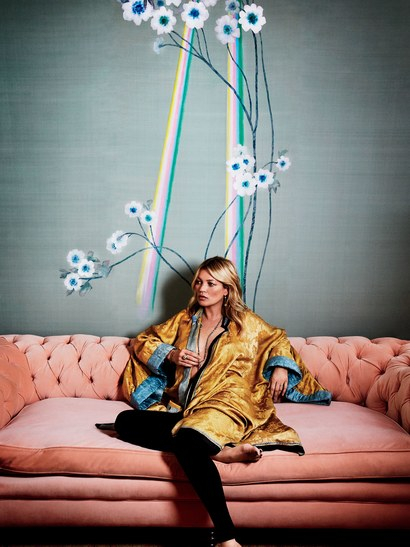 Kate Moss in her London entry hall, where the walls are dressed in the Daybreak version of the pattern in Light silk wall covering.
