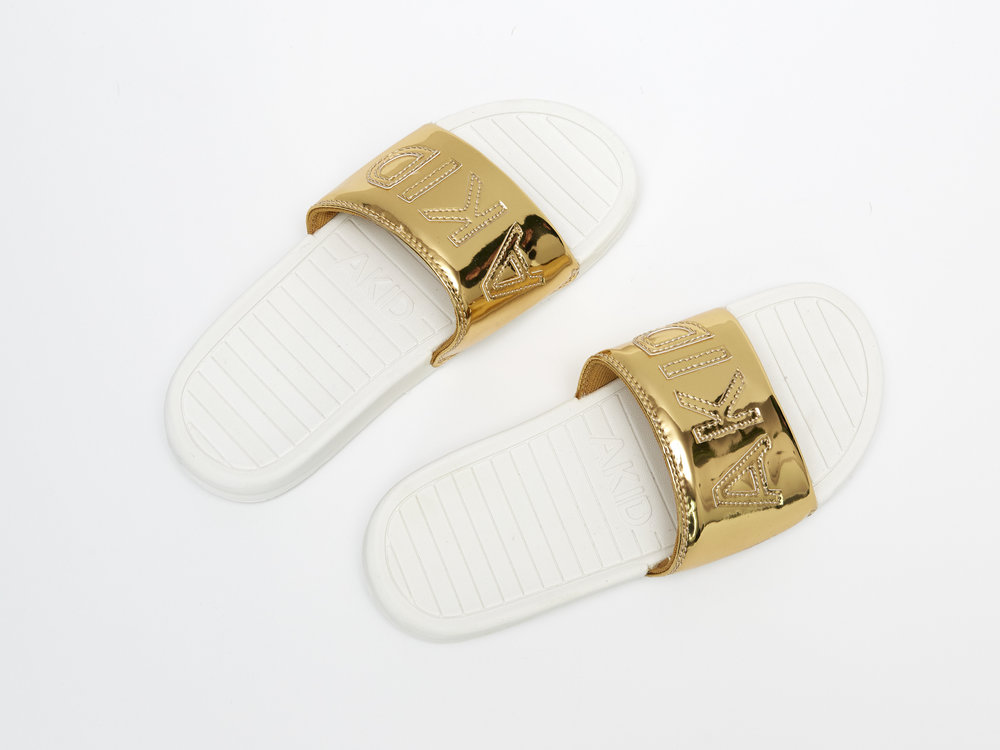 akid aston gold slip ons