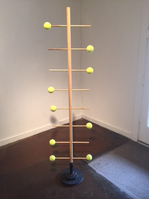 Erin Foley, Untitled (Support), 2016, steel, poplar, tennis balls, 72 x 18 x 12 in.