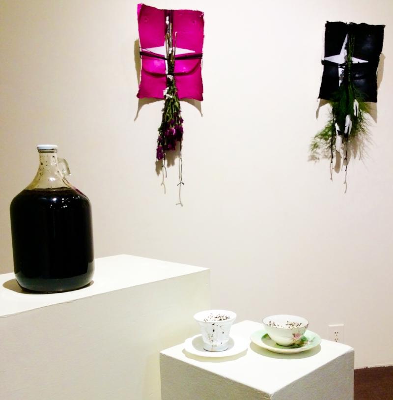 Sarah Rowe, Black Gold, crude oil, glass, Power Bundles 1-4, plaster cast, prayer ties, flowers