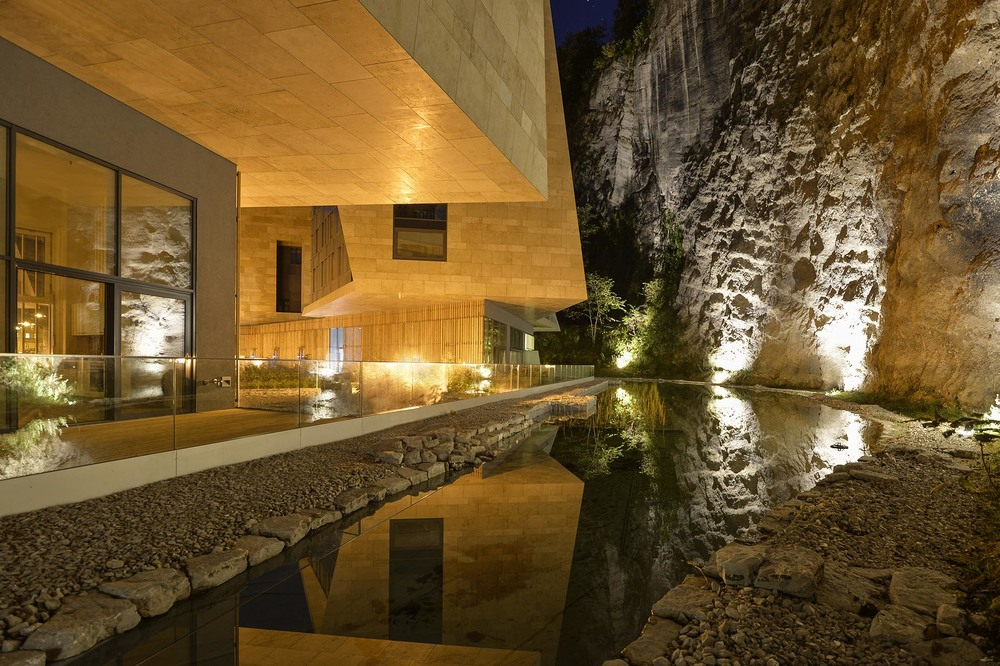 23 Night View of Building C ground floor terrace with water and rock face.jpg