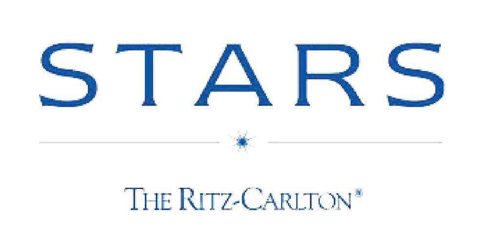 Ritz-Carlton STARS extras:  • Upgrade at check-in • 4:00 pm late check out • Free breakfast for two daily • Complimentary in-room amenity • Free Internet