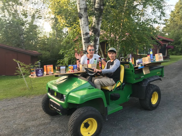 Here's Sean and Rowan hauling the huge load down to the boats, so we can start the show.  Redden's Camps generously contributed so the show could be even more spectacular.