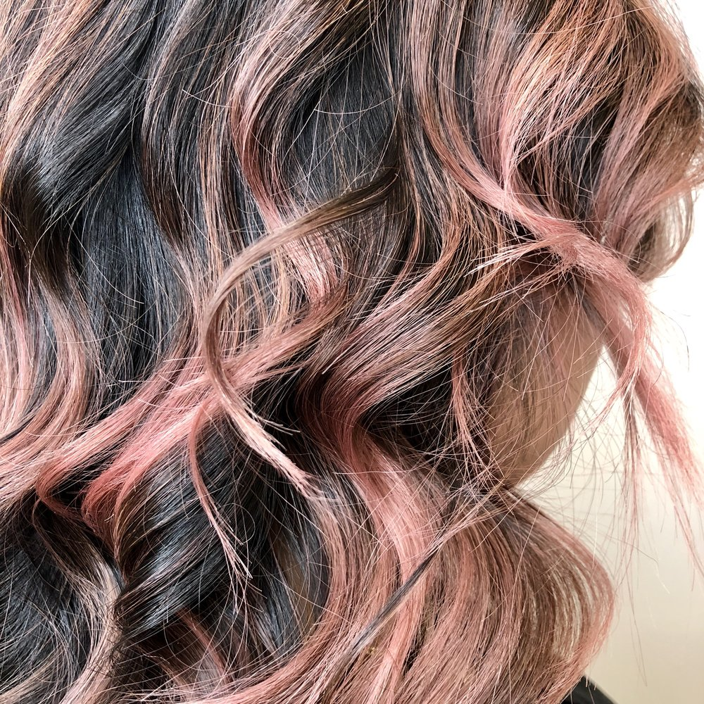 Washed-Out Pink - Pink hair is back on the scene for 2018! (#KimK) if the idea of pink hair intrigues and makes you nervous then a washed out subtle pink may be the solution for you. You will get the fun of an edgy color without the commitment or maintenance. If you have naturally light hair or are willing to lighten your hair then a light pink glaze can be applied. The glaze will show your natural hair color thru to give it a washed out look.