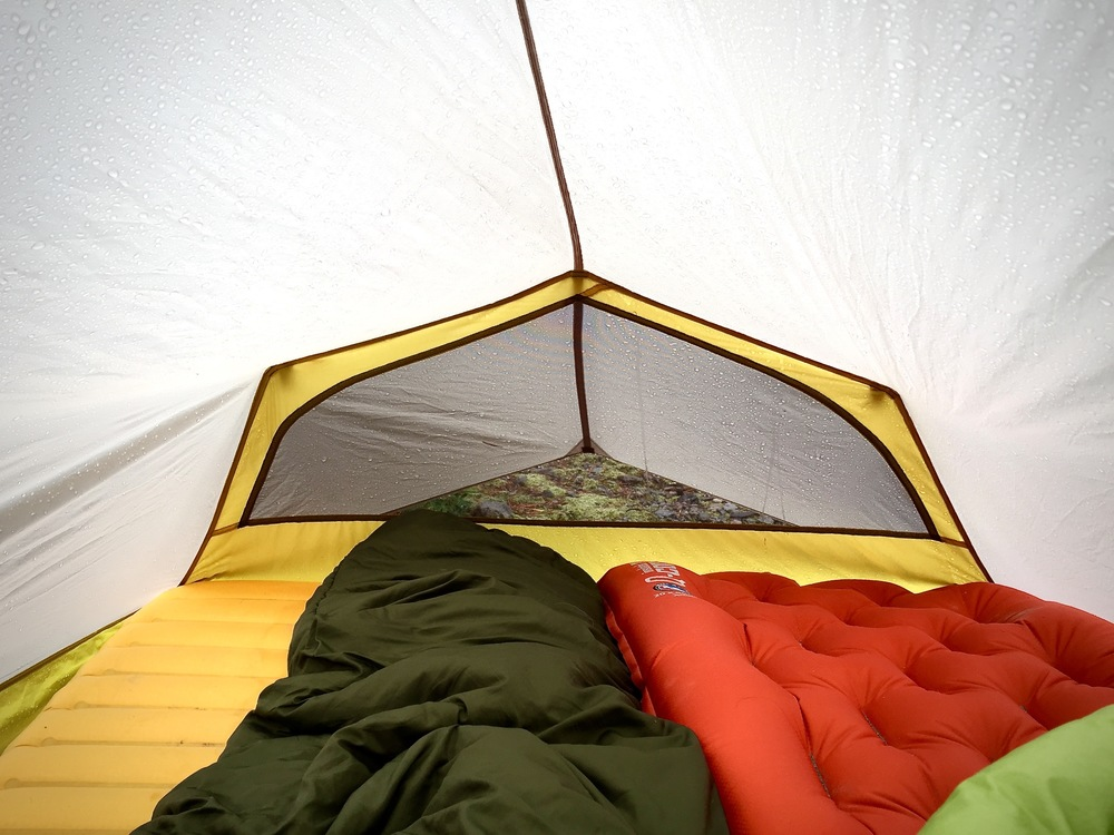 The Lightning 2 FL is roomy for one average sized backpacker and livable for two.  The back half of the tent body is a single layer which means there is no secondary barrier between you and the outside.  At times this means you may experience some condensation but by ventilating properly, it can certainly be avoided or significantly reduced.  If enough condensation accumulates, it can have a tendency to drip down and land on a sleeping back or pad but it's rarely enough to cause much concern.
