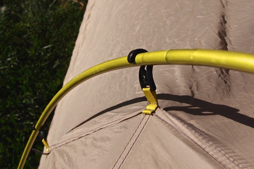 With the rain fly being connected to the main body of the tent as one unit, you'll see that the tent poles are now on the outside of the tent.  This creates a ridiculously easy way to pitch the tent quickly without soaking the interior if you happen to be pitching in the rain.  Easy on and easy off clips like the one pictured above makes life that much easier when setting up or breaking down camp.