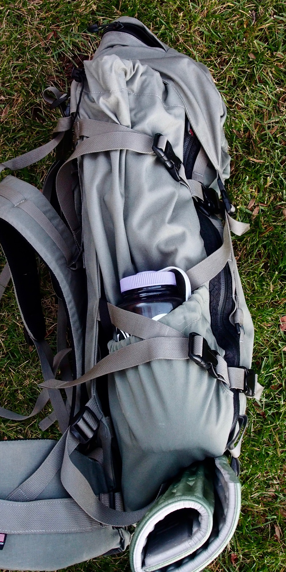 Two stretch pockets on either side of the Exo pack easily fit a 1 liter Nalgene bottle.