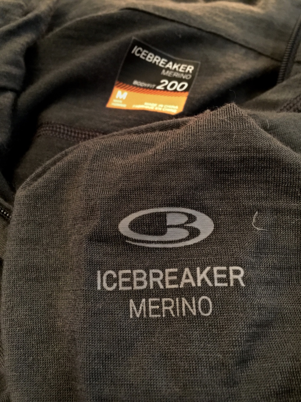 I've used this Icebreaker 200 weight Merino long sleeved half-zip on nearly all my hikes in 2015 and have loved it.  For me it's soft on my skin and I can wear it in the sun to protect my skin and on cool mornings.  100% Merino!