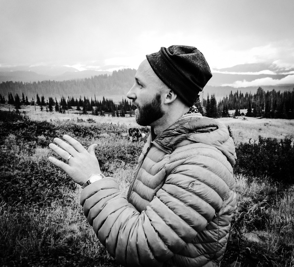 Beard, watch cap, and puffy jacket...check!  This photo was taken while I was testing out how well my puffy would do when used as a rain shell.  It survived, but wouldn't recommend doing this unless you have to.  Photo by Tabi Evans.