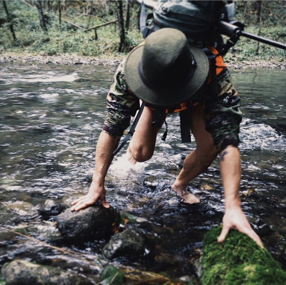 I love this shot of my friend coming out of the river.  He was smart and stowed his rifle after seeing me dunk mine in the river and also went with the no pants option.