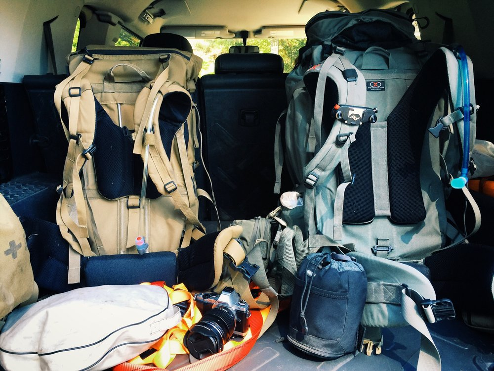 Both of these packs in this photo are from Exo Mountain Gear and both have fully adjustable suspensions.