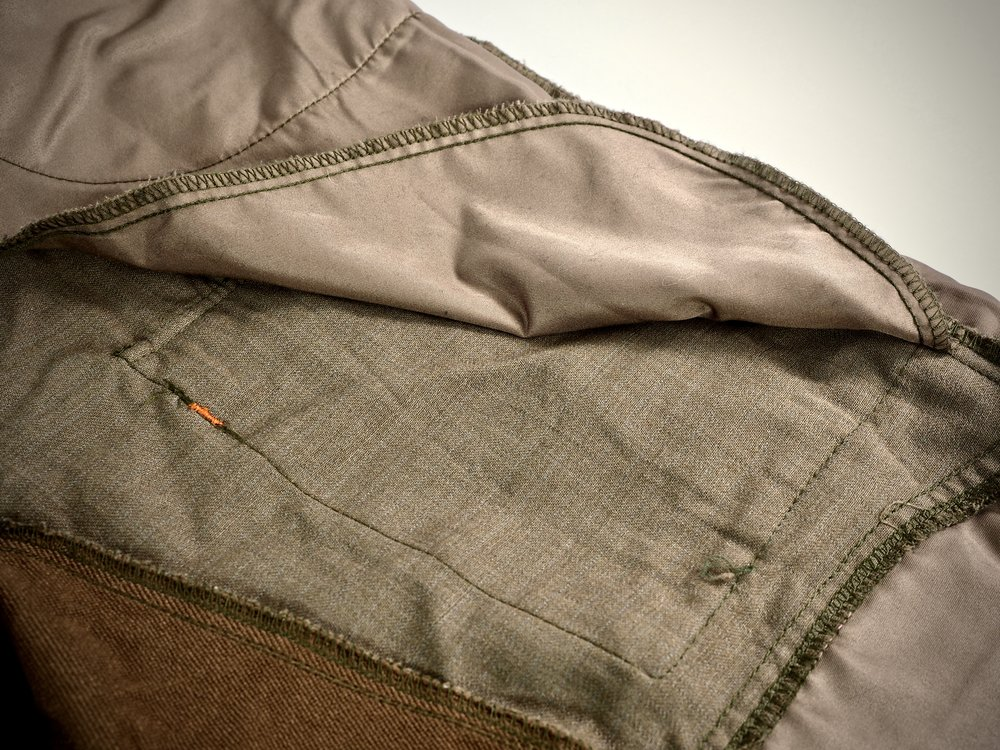 The square stitching in this picture is the outline of the cargo pocket.  Do you see how far down these things go!?  Whatever is in your front pocket, will reach all the way to the top of the knee.
