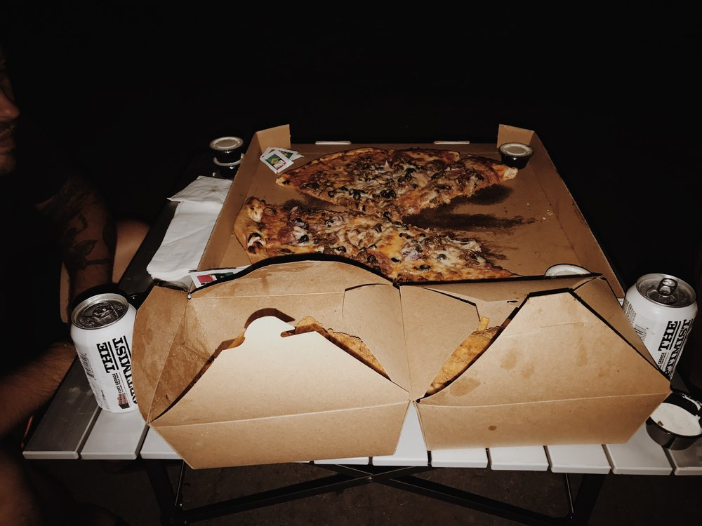 Late night pizza delivered by a friend in the area.