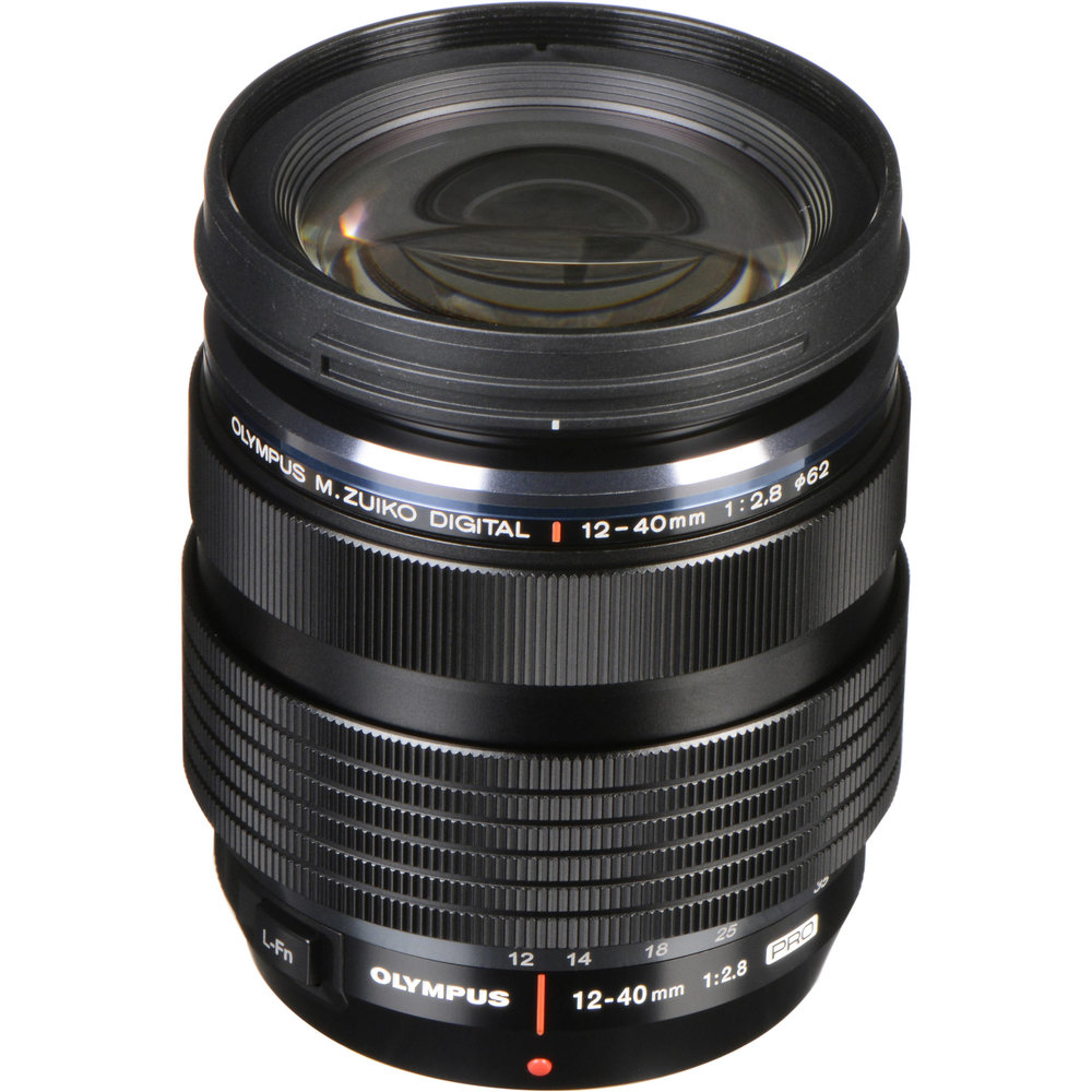 Olympus 12-40mm f2.8 Pro - An all around quality lens that is dust and splash proof. I've beat this lens up more than I care to admit and it continues to produce quality images.