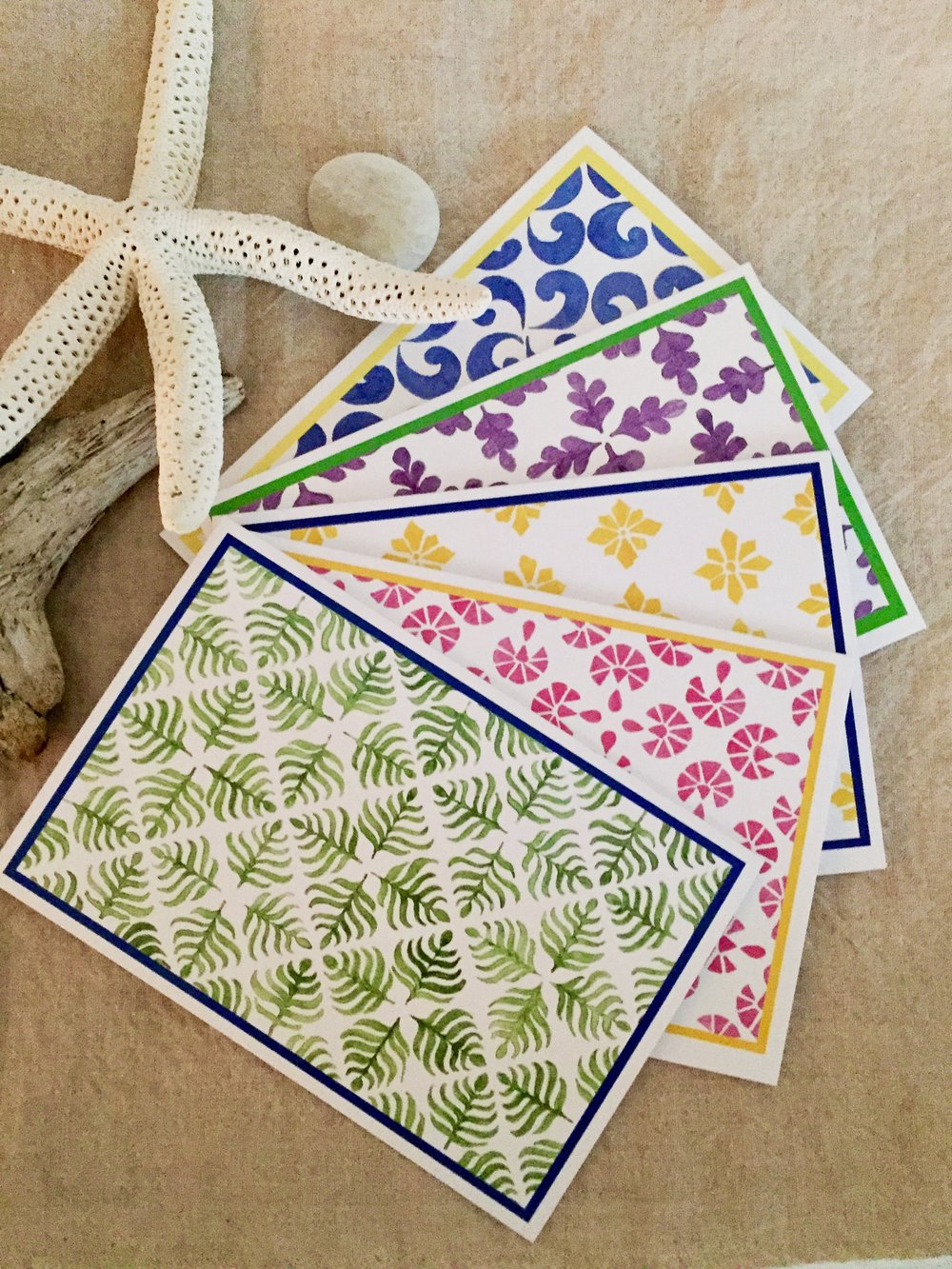 Reminiscent of the colorful tiles in Portugal, these hand painted notecards are bright and beautiful.  2 of each design with coordinated white envelopes are presented in a simple box with a clear cover.  Brighten someone's day with a personal handwritten note in their mail!