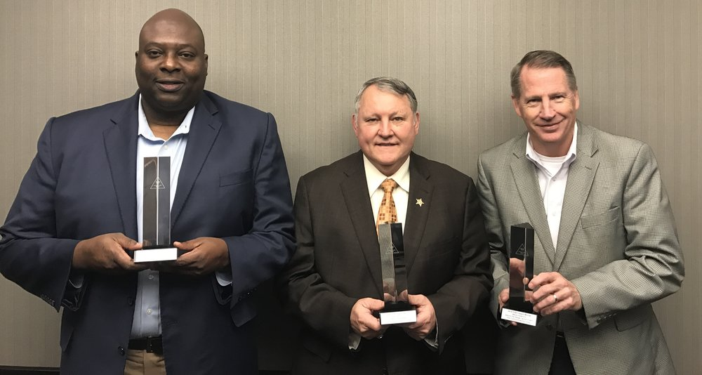 Left to right: Little Rock Police Chief Kenton Bucker, Pulaski County Sheriff Doc Holladay, North Little Rock Police Chief Mike Davis with Arkansas Behind the Badge Prism Awards