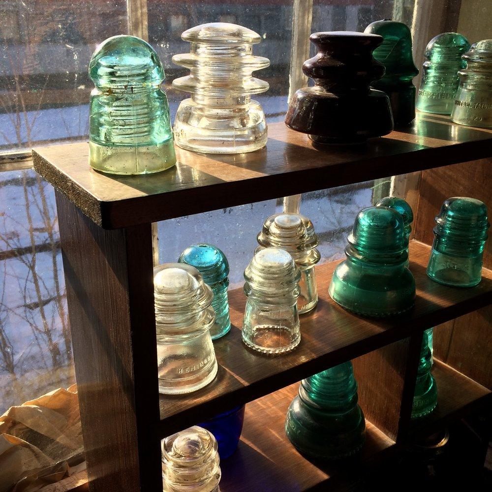 Glass insulators in the winter sun. Photo credit: Jimmy Grackle