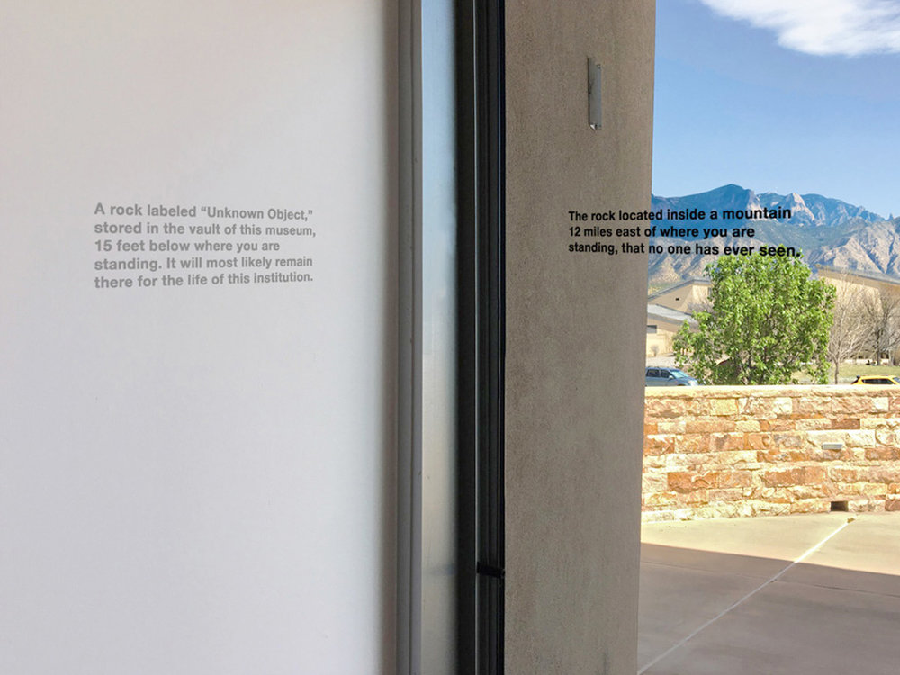 "Text on the left:  A rock labeled ""Unknown Object"" stored in the vault of this museum, 15 feet below where you are standing. It will most likely remain here for the life of this institution.   Text on the right:  The rock located inside a mountain 12 miles east of where you are standing, that no one has ever seen."