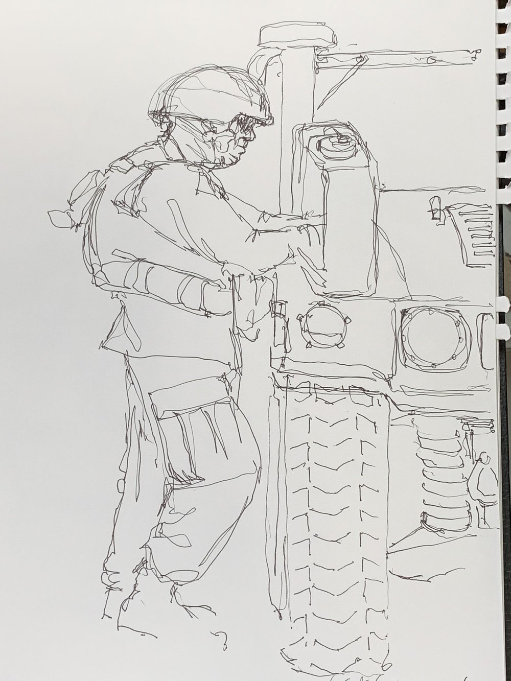 Gunnery Sergeant Guerra Charlie Battery 1/11 outside Fire Direction Control Tent working out a plan on the hood of a Humvee