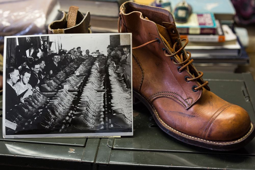 Australian WW II service boot beside an archival photo from an assembly line in Melbourne documenting the production of the boot.