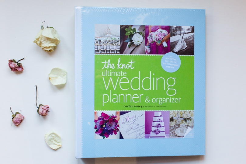 Shelby gave me this wedding planning book so I thought I'd snap a picture of it with the flowers of my bouquet from their wedding.