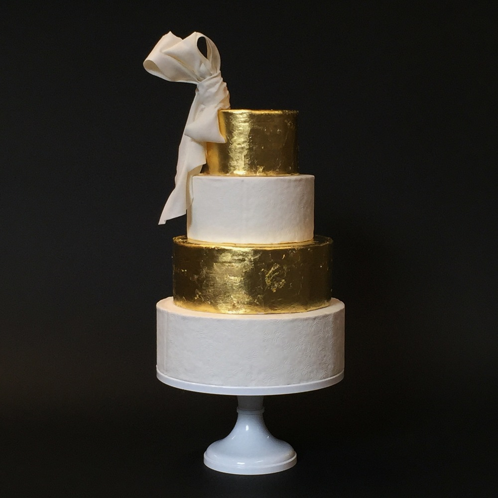 White and Gold Cake with Sugar Bow