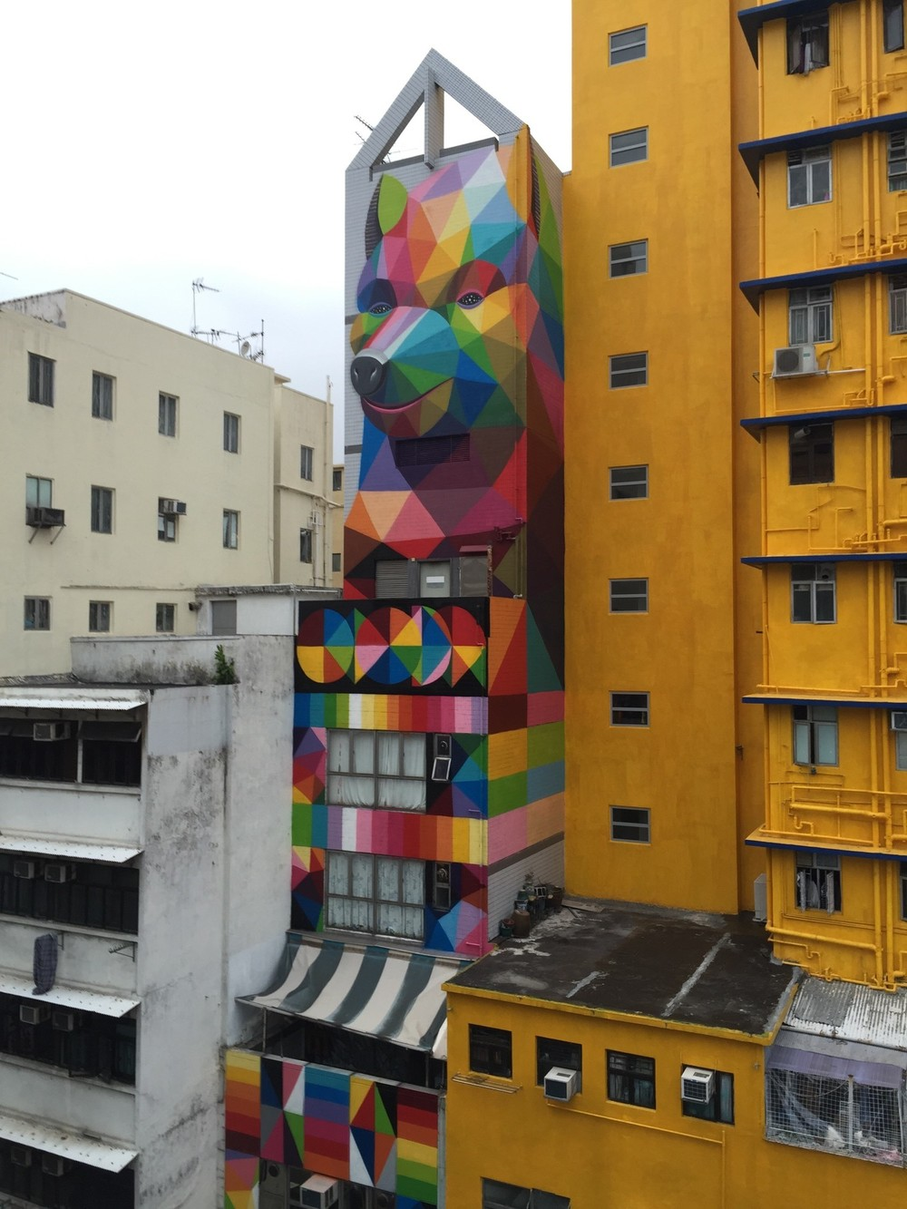 street art| rainbow thief by okuda san miguel